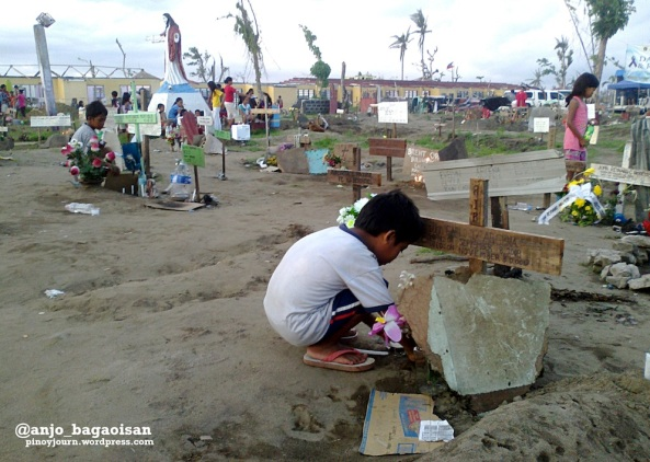 Children visit the tombs of family members at the mass grave in Palo, Leyte. (Shot by Anjo Bagaoisan)