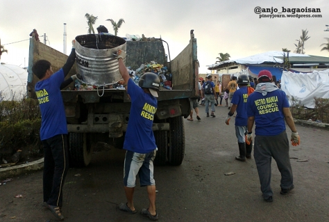 MMDA workers from Manila collect trash at the Tacloban City Airport (Shot by Anjo Bagaoisan)