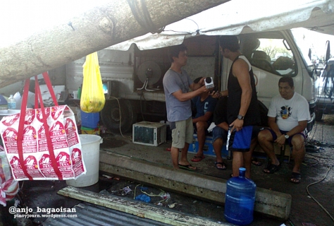 ABS-CBN crew preparing live setup at Tacloban Airport after Yolanda (Shot by Anjo Bagaoisan)