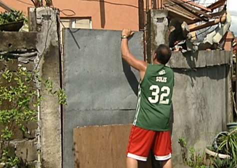 The few people left in the subdivisions look after homes damaged by the typhoon and whose owners left the town. (Shot by Archie Torres, ABS-CBN News)