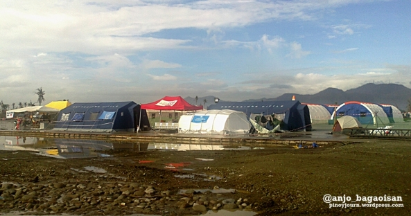 Tents of international relief and rehabilitation workers outside the Tacloban City Airport Line of survivors waiting for free ride on C-130 planes at the Tacloban City Airport, as the DSWD already prohibited such hitches. (Shots by Anjo Bagaoisan)