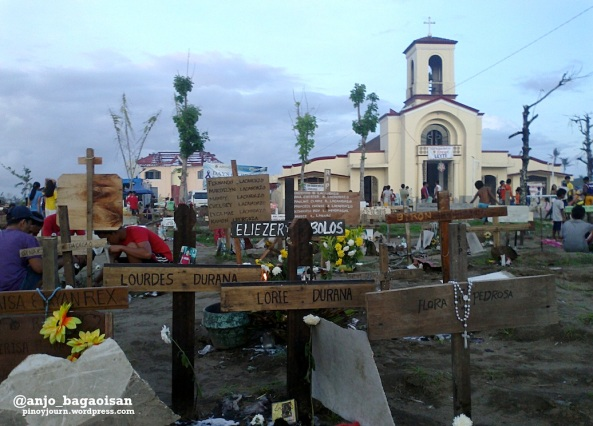 The mass grave in Barangay San Joaquin, Palo, Leyte, with the barangay chapel in the background.