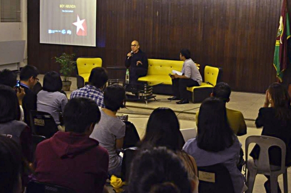 Boy Abunda talks to students at a forum in the University of the Philippines College of Mass Communication. (Photo by Beata Carolino, UP Journalism Club)