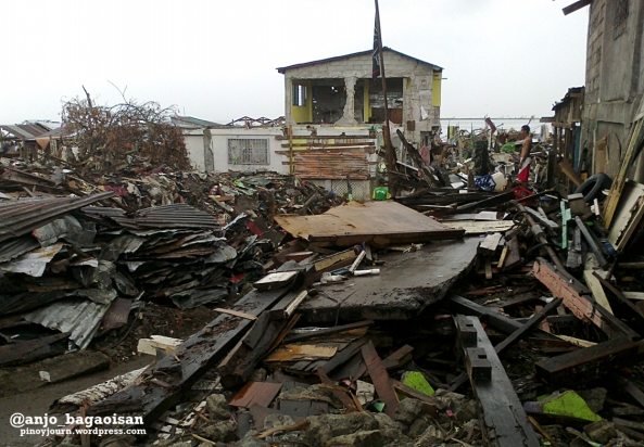 Debris and damaged houses in Magallanes district of Tacloban City. (Shot by Anjo Bagaoisan)