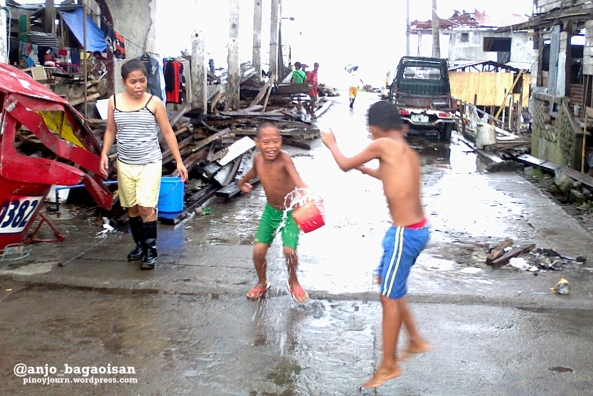 Two boys splash each other with water at Magallanes district in Tacloban City. (Shot by Anjo Bagaoisan)