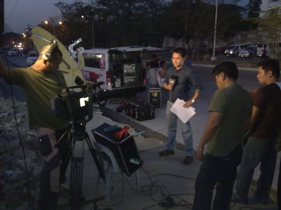 ABS-CBN News reporter Adrian Ayalin preparing for a live report at the Ombudsman (Shot by Anjo Bagaoisan)