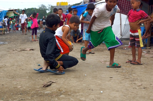 Children play at the evacuation center at  Joaquin F Enriquez Sports Complex in Zamboanga City. (Shot by Anjo Bagaoisan)