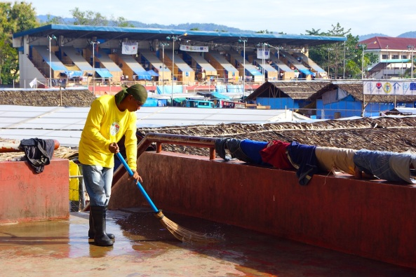 A sweeper cleans the grandstand of the Joaquin F Enriquez Sports Complex in Zamboanga City. (Shot by Anjo Bagaoisan)