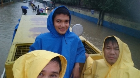 On a truck, crossing the flood: ABS-CBN News systems team members Gillian, Benhur and Carlo (Shot c/o Gillian Catindig)