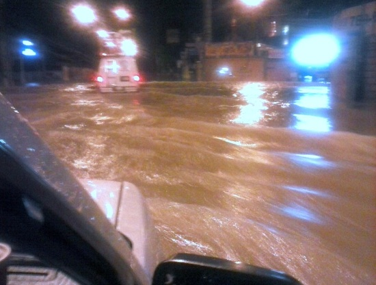 ABS-CBN ENG van wading through floods in Cainta, Rizal during Tropical Storm Mario. (Shot by Anjo Bagaoisan)