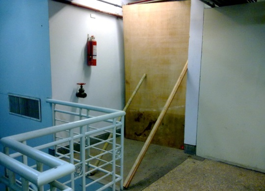 Planks block the fire exits of Makati City Hall during the suspension of Mayor Jejomar Binay (Shot by Anjo Bagaoisan)