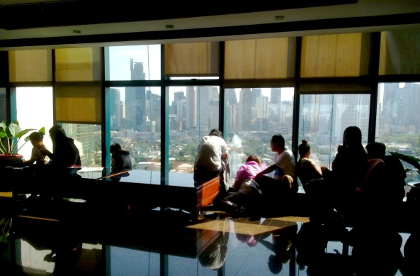 Visitors at Makati City Hall 21st floor view the skyline (Shot by Anjo Bagaoisan)