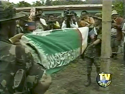 The MILF flag is brought down after the seizure of Camp Abubakar. (Grab from ABS-CBN's TV Patrol)