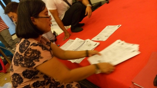 Comelec media rep Rachel Fortuno arranging copies of the COCs filed on the first day of filing for elections 2016 (Shot by Anjo Bagaoisan)