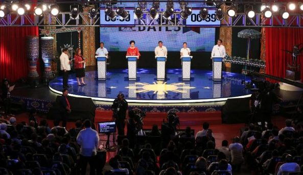 Philippines presidential candidates (L-R) vice President Jejomar Binay, Senator Mirrian Defensor-Santiago, Davao City Mayor Rodrigo Duterte, Senator Grace Poe, and Mar Roxas stand in a podium as they participate in a debate held in Cagayan de Oro, southern Philippines on February 21, 2016.