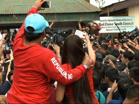 Couple waits for Duterte in Davao City precinct before he casts his vote (Shot by Dong Plaza, ABS-CBN News)