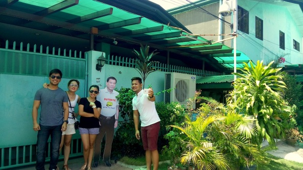 Visitors take a shot at the Duterte residence in Davao city with a stand-in of President Rodrigo Duterte (Shot by Anjo Bagaoisan)