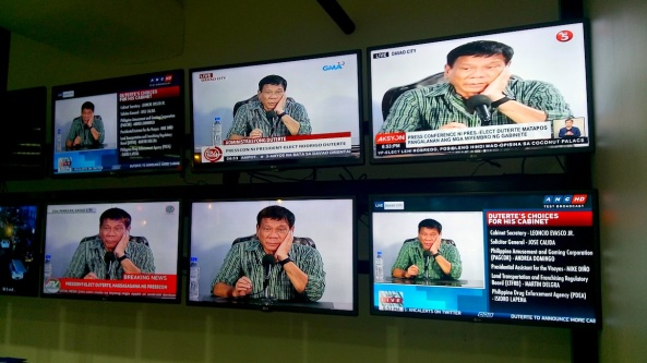Monitors of Philippine TV networks showing a live press conference of Rodrigo Duterte (Shot by Anjo Bagaoisan)