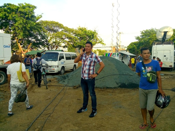 ABS-CBN's Jeck Batallones making a phone call (Shot by Anjo Bagaoisan)