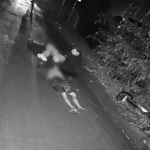 2 upturned corpses of riders killed in police encounter who were also alleged hired killers. (Courtesy Pasay City PNP)