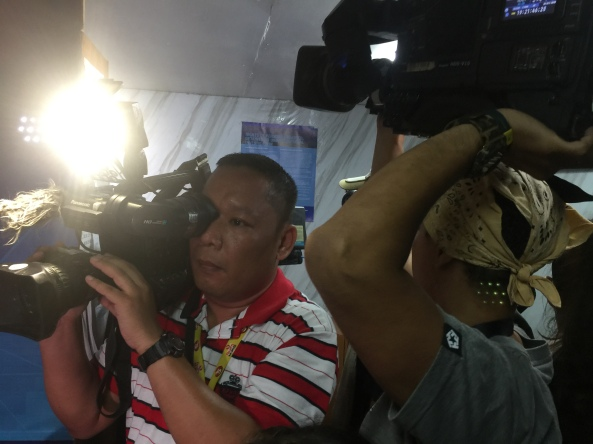 TV news cameramen jockey for position in the small room of the MPD Station 1 drug enforcement office. (Shot by Anjo Bagaoisan)