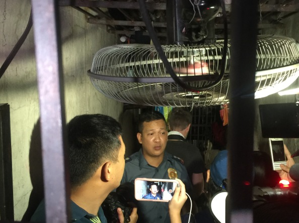 "Supt. Robert Domingo shows reporters inside the ""improvised"" jail cell at the MPD Station 1. (Shot by Anjo Bagaoisan)"