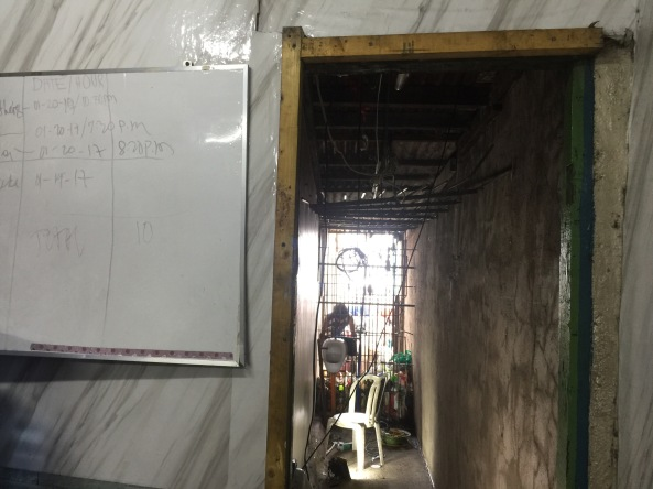 The book shelf was removed from the entrance to the hidden jail cell in Manila Police Station 1 the morning after it was discovered. (Shot by Anjo Bagaoisan)