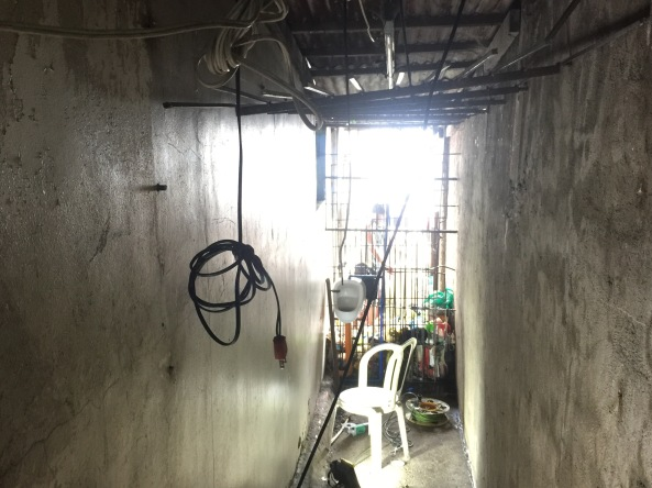 Bars and ventilation were removed from the entrance to the hidden jail cell in Manila Police Station 1 the morning after it was discovered. (Shot by Anjo Bagaoisan)