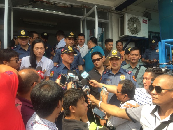 MPD Station 1 commander Supt. Robert Domingo looks on as NCRPO Dir. Oscar Albayalde and MPD director Chief Supt. Joel Coronel talk to reporters after visiting the controversial secret jail cell in MPD station 1. (Shot by Anjo Bagaoisan)
