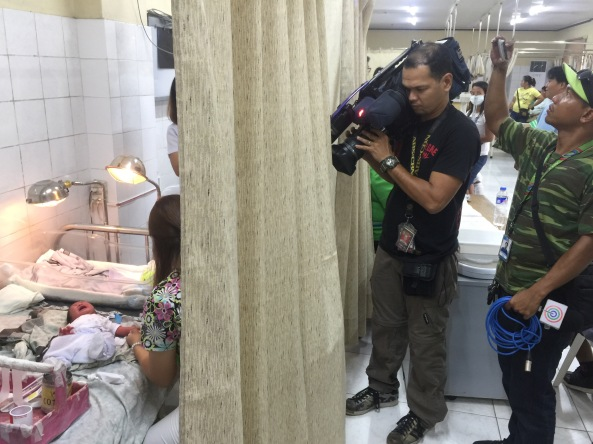 The baby being given antibiotics at the ER of the Sta Rosa Community Hospital while being filmed by a TV crew. (Photo by Anjo Bagaoisan)