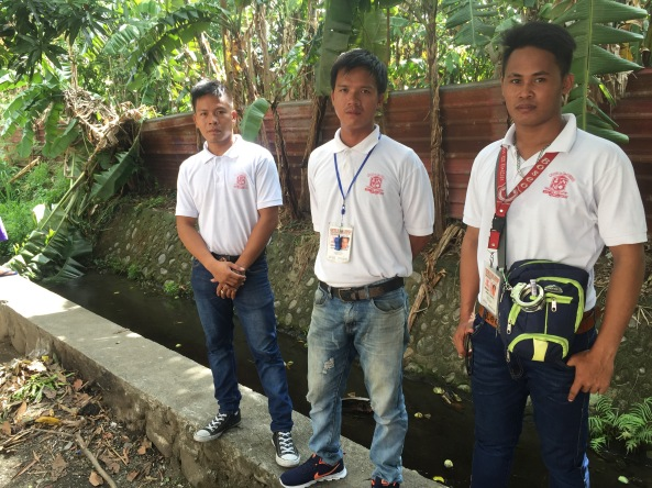 (L-R) Jesse Custorio, Arjay Pornasdoro, and Romel Ibañez, the community brigade volunteers who found the baby at the creek in Centro de San Lorenzo in Sta. Rosa, Laguna. (Photo by Anjo Bagaoisan)